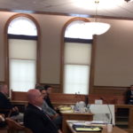 Reginald Dobbins (sat far end of defense table) sits with his defense attorney, Hunter Tzovarras, and listens during closing statements Tuesday in Aroostook County Superior Court in Houlton.