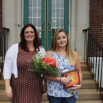 Deb Sanford, Deb Sanford, MBA, MSN, RN, vice president of Nursing and Patient Care Services at Eastern Maine Medical Center, presents Haley Harrison, CNA, Grant 6 Respiratory, with the 2017 SUNSHINE Award.