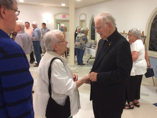 Fr. Rudolph Leveille greets members of St. Paul the Apostle Parish in the parish hall at St. John Catholic Church in Bangor on Saturday, June 17 at a celebration of his 60 years in the priesthood.