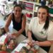 2016 Gauvin Scholar, Emilia Churchill (right), and 2016 Gauvin Scholar, Brittany Corey, (right) prepare plates of food to distribute to communities for their Kindness Plate Project.