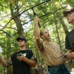 Wildlife Biologist Brent Bibles works with Unity College students out in the field.