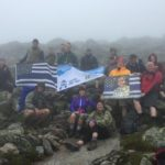 """On Saturday, 18 members of several police departments from across the state joined forces to summit Maine's highest mountain to honor fallen officers as part of the national """"Cops on Top"""" Summit for Heroes event."""