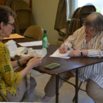Wiscasset Election Clerk Joan Barnes (left) and Election Warden Susan Blagden re-tally the results of Wiscasset's annual town meeting by referendum at the Wiscasset town office on Thursday, June 22.