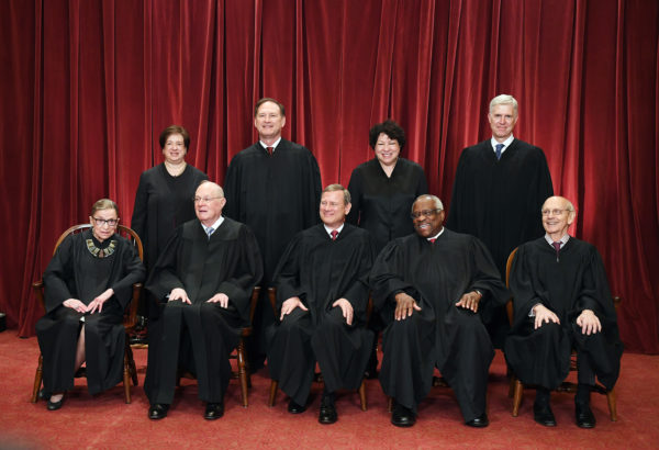 Seated from left, Associate Justice Ruth Bader Ginsburg, Associate Justice Anthony Kennedy, Chief Justice of the United States John Roberts, Associate Justice Clarence Thomas, and Associate Justice Stephen Breyer. Standing behind from left, Associate Justice Elena Kagan, Associate Justice Samuel Alito, Associate Justice Sonia Sotomayor and Associate Justice Neil Gorsuch pose at the Supreme Court on June 1.