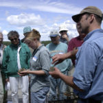 """Maine Sea Grant staffers explain experimental scallop aquaculture to visitors at University of Maine's Darling Marine Center in South Bristol in this 2010 file photo. On Thursday, a congressional panel voted to support funding the national Sea Grant program in next year's federal budget despite President Trump's proposal to defund it."""