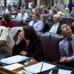 House Minority Leader Ken Fredette (right), R-Newport, watches as votes come in on a vote board during the House of Representatives vote on the state budget at the Maine State House in Augusta Wednesday. Lawmakers are scurrying to avoid a state government shutdown.