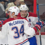 Montreal's Brian Flynn (32) celebrates with right wing Michael McCarron after scoring a goal in an October 2016 game. Flynn has signed a contract with the Dallas Stars, joining two other former University of Maine standouts.