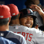 Boston Red Sox right fielder Mookie Betts (50) is greeted by team mates after scoring against Toronto Blue Jays in the seventh inning Sunday at Rogers Centre. Mandatory Credit: Dan Hamilton-USA TODAY Sports