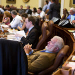 Sen. Dave Woodsome, R-North Waterboro, leans back in his chair while listening to arguments during the Senate's hearing on the state budget at the Maine State House in Augusta, June 30, 2017.