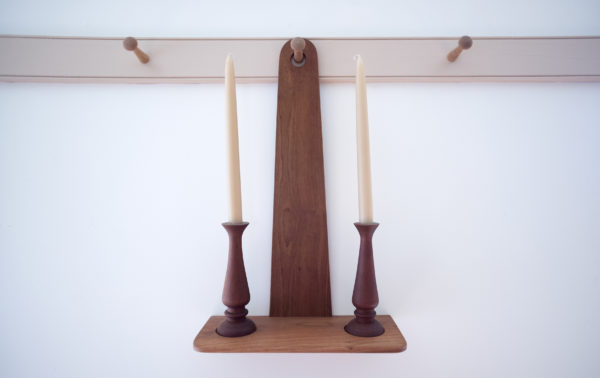 A set of candle holders made by Kenneth Copp of Thorndike in his furniture shop. Copp, 57, spent decades living in old-order Mennonite and Amish communities in several states. He started questioning his religious beliefs and in 2012 left the Amish church. He was shunned by the Amish community and eventually lost his family. He says aspects of his new life are very hard, but he is happier and more at peace now.