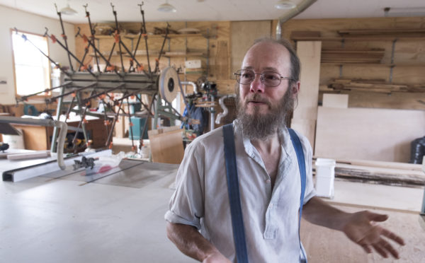 Kenneth Copp of Thorndike in his furniture making shop. Copp, 57, spent decades living in old-order Mennonite and Amish communities in several states. He started questioning his religious beliefs and in 2012 left the Amish church. He was shunned by the Amish community and eventually lost his family. He says aspects of his new life are very hard, but he is happier and more at peace now.