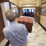 After the Maine State Senate voted for the state budget bill the papers associated with the bill are carried to the Clerk of the Maine House of Representatives in Augusta Monday afternoon.