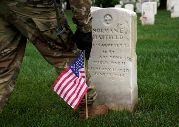 """A soldier from the 3rd U.S. Infantry Regiment (Old Guard) takes part in &quotFlags-in"""", where a flag is placed at each of the 284,000 headstones at Arlington National Cemetery ahead of Memorial Day, in Arlington, Virginia, May 25, 2017."""