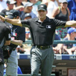 First base umpire Angel Hernandez, after a review, called Mitch Haniger of the Seattle Mariners safe at home plate in the second inning against the Houston Astros, but then changed it to an out at Safeco Field in Seattle, June 25, 2017.