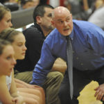 Brewer High School head coach Andy Nickerson keeps his eye on a Brewer rebound during a Class A girls basketball prelim against Bangor at Brewer High School in 2012.