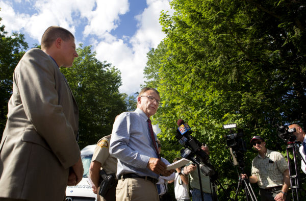 Maine Department of Public Safety spokesman Stephen McCausland (center) addresses the media during a press conference on Russell Road in Madison.