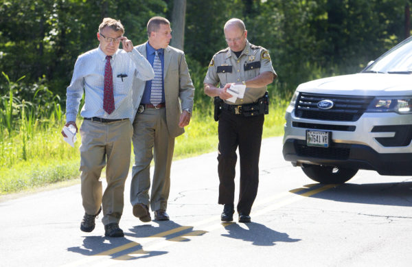 Maine Department of Public Safety spokesman Stephen McCausland  (left) walks up for a press conference with Lt. Jeff Love, Maine State Police Major Crimes, and Sheriff Dale Lancaster at a road block on Russell Road in Madison where Somerset County Sheriff's deputies shot and killed a man suspected of shooting four people early Wednesday morning in Madison.