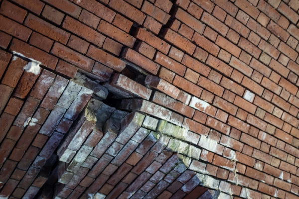 Loose bricks hang precariously from a vaulted ceiling inside Portland's Fort Gorges.