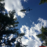 A Maine Forest Service helicopter airlifts an injured hiker from the Appalachian Trail about 15 miles east of Greenville. The hiker suffered a broken leg, and was taken to a Bangor hospital for treatment.