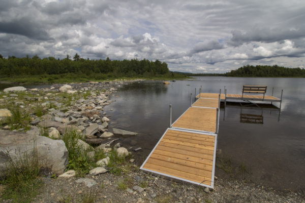 Grey clouds gather over Second Roach Pond on June 27, seen from the dock of Medawisla Wilderness Lodge and Cabins, which were recently re-constructed and officially opened to the public in July 1. The off-the-grid lodge and cabins are a part of a system of trails and similar wilderness lodges run by the Appalachian Mountain Club just east of Moosehead Lake.