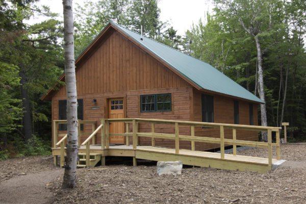 A wheelchair-accessible bunkhouse is one of many buildings that make up the newly constructed Medawisla Wilderness Lodge and Cabins on June 27, an outdoor destination that is a a part of Appalachian Mountain Club's system of trails and similar wilderness lodges just east of Moosehead Lake. The new lodge and cabins opened on July 1, after a year and a half of construction.