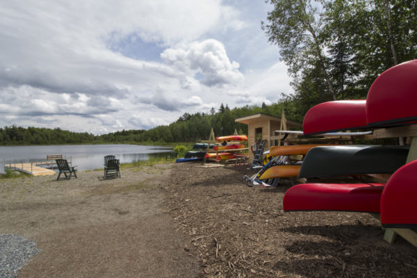 Canoes, kayaks and stand-up paddle boards are available to guests of the newly constructed Medawisla Wilderness Lodge and Cabins, which opened on June 1, on the shore of Second Roach Pond. The off-the-grid lodge and cabins are a part of a system of trails and similar wilderness lodges run by the Appalachian Mountain Club just east of Moosehead Lake.