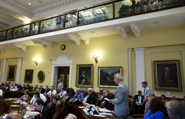 Sen. Roger Katz (right), R-Augusta, talks to other members of the Senate about the budget at the Maine State House in Augusta on Friday, June 30.