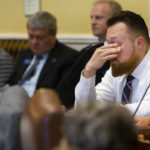 Sen. Garrett Mason, R-Lisbon Falls, puts his hands to his face while listening to arguments during the Senate's hearing on the state budget at the Maine State House in Augusta.