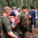 A team of rescuers carries an injured hiker off Borestone Mountain on Thursday, July 6, 2017.