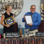 Mari Eosco, chairwoman of the Bath City Council, presents Bill Giroux with the ceremonial Key to the City and a certificate of appreciation during Giroux's last week as city manager in Bath.