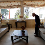 A pensioner sits down in a residential home for the elderly in Marseille, France.