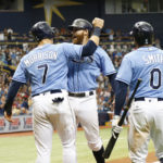 Tampa Bay Rays second baseman Brad Miller (center) is congratulated by  first baseman Logan Morrison (left) and center fielder Mallex Smith after he hit a go-ahead home run against the Boston Red Sox at Tropicana Field in St. Petersburg, Florida, on Sunday.