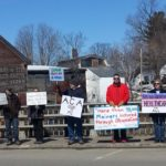 Caption Local residents concerned about health care legislation gathered on the East Main Street bridge in Dover-Foxcroft on March 26.
