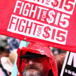 """Mike Goodman, of Madison, Wisconsin, joins anti-Trump activists during a """"March on McDonald's"""" for an increase in the minimum wage, in Chicago, Illinois, U.S., May 23, 2017."""