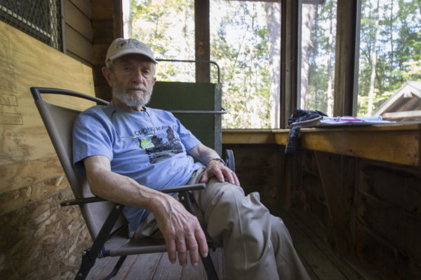 Ron Davis, founder of the Orono Bog Boardwalk, sits in the maintenance cabin near the boardwalk's beginning on July 5, in the Rolland F. Perry City Forest in Bangor. Ron Davis and his wife, Lee Davis, volunteer at the boardwalk as docents each Wednesday, answering people's questions and making sure they follow rules. For example, dogs are not permitted on the boardwalk.