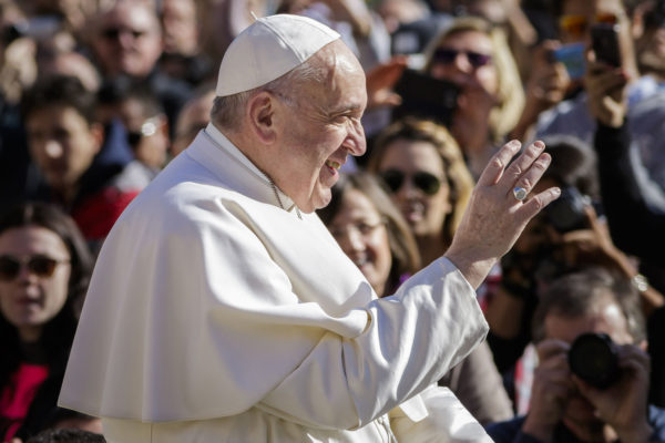 Pope Francis rides on the Popemobile through the crowd of the faithful as he arrives to celebrate his Weekly General Audience in St. Peter's Square on March 1, 2017 in Vatican City, Vatican.