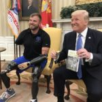 Retired Army Staff Sgt. Travis Mills, a Maine soldier who lost part of all four of his limbs in Afghanistan who is now an advocate for injured veterans, met with President Donald Trump in an impromptu meeting on Monday.