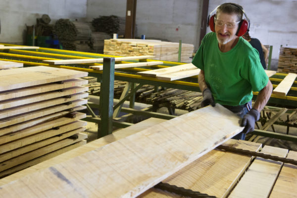Barry Cook works to sort lumber at a St. Albans sawmill called Sebasticook Lumber on June 15, 2017.