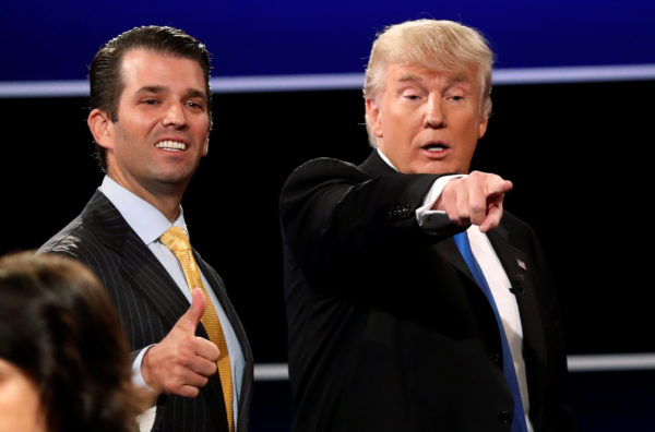 Donald Trump Jr. (L) gives a thumbs up beside his father Republican U.S. presidential nominee Donald Trump (R) after Trump's debate against Democratic nominee Hillary Clinton at Hofstra University in Hempstead, New York, Sept. 26, 2016.