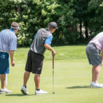 Scott Sirois (left), Joe Baker and Mark Plummer follow the path of Plummer's putt at the Brunswick Golf Club on Tuesday during the first round of the 2017 Maine Amateur Championship.   Andree Kehn | Sun Journal