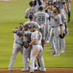 Robinson Cano of the Seattle Mariners (front, second from left) celebrates with American League teammates Francisco Lindor (12), Nelson Cruz (23) and Yonder Alonso (17) after Cano hit a game-winning home run in the 10th inning of the AL's 2-1 win over the National League during the MLB All-Star Game on Tuesday at Marlins Park in Miami. (David Santiago/Miami Herald/TNS)