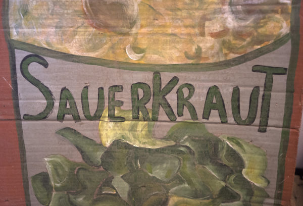 An old sign painted on cardboard at Thirty Acre Farm. Besides the traditional sauerkraut they make a variety of other fermented vegetables and hot sauces.