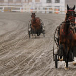 Drivers and horses make their way around the track at the Bangor Raceway.