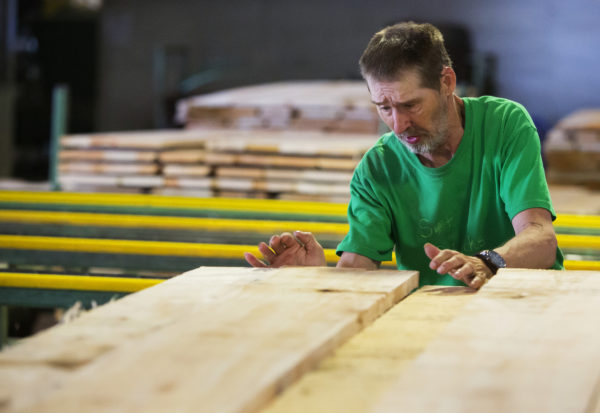Barry Cook works to sort lumber at Sebasticook Lumber in St. Albans.