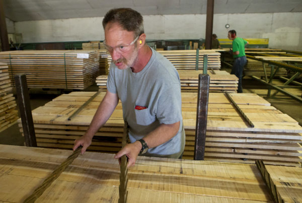 Scott Ladd works to sort lumber at Sebasticook Lumber in St. Albans.