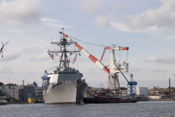 The USS Sampson sails away from Bath Iron Works.