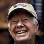 Former U.S. President Jimmy Carter attends a Habitat for Humanity home building site in the Ivy City neighborhood of Washington, Oct. 4, 2010.