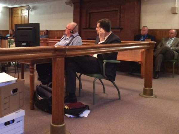 Robert Craig, 81, wears headphones to better hear the proceedings in his murder trial in Aroostook County Superior Court in Caribou on Friday, July 14. Craig was found guilty of intentional or knowing murder for the July 2016 slaying of 86-year-old Leo Corriveau of Presque Isle.