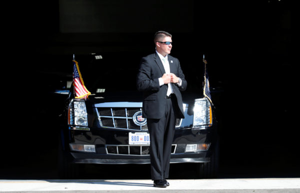 A Secret Service agent stands guard over the Presidential limo as U.S. President visits Waukesha County Technical College in Pewaukee, Wisconsin, on June 13, 2017.