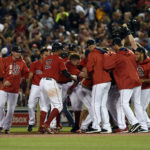 Members of the Boston Red Sox react after a walk-off win during the ninth inning against the New York Yankees at Fenway Park in Boston on Friday night.